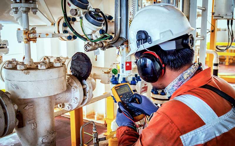 Operator repairing pipes at cruise ship
